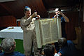 US Navy 081006-N-4005H-078 Cmdr. Joel Newman, left, a Rabbi aboard the Nimitz-class aircraft carrier USS Ronald Reagan (CVN 76), unrolls a Torah in the ships chapel during an introduction class to the Jewish religious holiday o.jpg