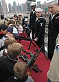 US Navy 081013-N-6439C-016 New York residents learn about weapons during a tour of the amphibious assault ship USS Nassau (LHA 4).jpg