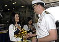 US Navy 090206-N-8283S-185 Capt. Frank Michael, executive officer of the amphibious assault ship USS Boxer (LHD 4), presents a command coin to each member of the San Diego Chargers cheerleaders during their visit aboard Boxer.jpg
