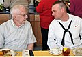 US Navy 090507-N-8848T-201 Dean Garrett, from Freeport, Ill., speaks to Seaman Recruit Levi Frazier, from Winchester, Ky., during lunch.jpg