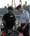 US Navy 090714-N-5677B-058 Gen. Douglas Fraser, commander, U.S. Southern Command speaks with a member of the visit, board, search, and seizure team of the guided-missile frigate USS McInerney (FFG 8) during a tour of the ship.jpg