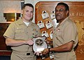 US Navy 091117-N-0569T-034 The Surface Warfare Officer of the Year award is presented to Lt. Cmdr. Jeffrey Tamulevich, left, by Vice Adm. D. C. Curtis, commander, Naval Surface Forces, aboard the guided-missile destroyer USS Jo.jpg