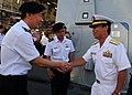 US Navy 100702-N-3570S-008 Singapore navy Capt. Giam Hock Koon welcomes aboard Rear Adm. Kazuki Yamashita to Rim of Pacific (RIMPAC) 2010 Singapore Reception.jpg