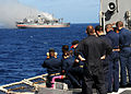 US Navy 101027-N-6632S-469 Sailors aboard the guided-missile cruiser USS Gettysburg (CG 64) observe the Ex-USNS Saturn during a sinking exercise.jpg