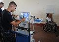 US Navy 110610-N-QD416-104 Hospital Corpsman 2nd Class Robert Hooffstetter takes an X-ray of a man paralyzed by a shotgun blast at the Escuela Max.jpg