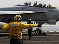 US Navy 110708-N-XE109-081 Sailors signal the completion of pre-flight launch checks on an F-A-18F Super Hornet aboard USS George H.W. Bush (CVN 77.jpg