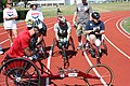 US Navy 110716-N-CQ678-003 Military Paralympic athletes receive last-minute instructions before the first heat of a wheelchair race.jpg