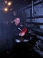 US Navy 110916-N-CY408-073 Chief petty officer selects from the aircraft carrier USS Nimitz (CVN 68) secure a valve during a flooding training scen.jpg
