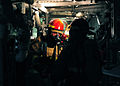 US Navy 111011-N-ED900-453 Fire assessment team members discuss the proper route to take while searching for a simulated fire in a main engine room.jpg
