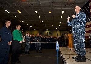 US Navy 120112-N-FI736-007 Master Chief Petty Officer of the Navy (MCPON)Rick D. West speaks to Sailors during an all-hands call aboard the aircraf.jpg