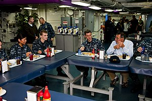 US Navy 120121-N-FI736-150 Secretary of Defense (SECDEF) Leon Panetta speaks to the crew during lunch aboard the aircraft carrier USS Enterprise (C.jpg