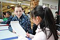 US Navy 120201-N-TO330-188 A Sailor answers questions from a Terao Elementary student.jpg