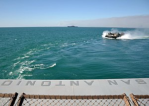 US Navy 120201-N-VL218-007 Landing Craft Air-Cushion (LCAC) 37 approaches the well deck of the amphibious transport dock ship USS San Antonio (LPD.jpg
