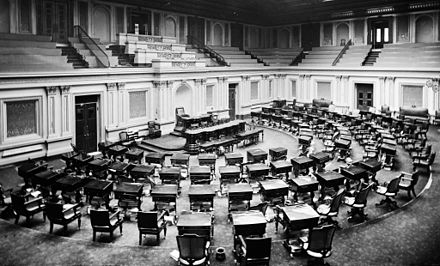 U.S. Senate chamber c. 1873: two or three spittoons are visible by desks US Senate Chamber c1873.jpg