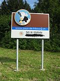 Vandalized bilingual sign in the Canton of Fribourg.jpg
