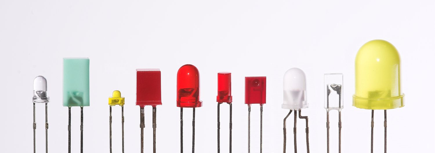LEDs are produced in a variety of shapes and sizes. The color of the plastic lens is often the same as the actual color of light emitted, but not always. For instance, purple plastic is often used for infrared LEDs, and most blue devices have colorless housings. Modern high-power LEDs such as those used for lighting and backlighting are generally found in surface-mount technology (SMT) packages (not shown). Verschiedene LEDs.jpg