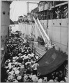 Vietnam refugees. USS Montague lowers a ladder over the side to French LSM to take refugees aboard. Haiphong, August 195 - NARA - 521001.tif