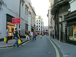 Vigo Street - The start of Vigo Street, looking east towards Regent Street. The Penguin Books plaque is on the brick building on the right.