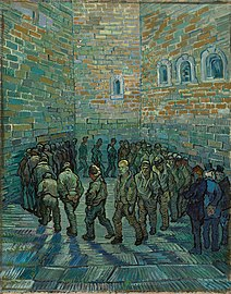 In an indoor prison yard a large group of men walk in a circle, one behind the other. The face of the prisoner in the centre of the painting and looking toward the viewer looks like Van Gogh.
