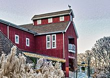 Image of Westport Country Playhouse which is a red barn building.