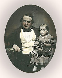 photo of a Victorian man with a girl on his lap