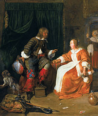 Woman offering a glass of wine to a man
