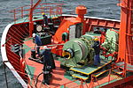 Workers prepare for refueling at sea (5655707879).jpg