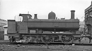 GWR 645 Class - No. 1532 at Croes Newydd Depot, 1947. This was built as a standard saddle-tank in 1879, and acquired its panniers in 1921