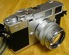Zeiss Ikon ZM 35 mm rangefinder camera with Planar T* 50mm F2 lens and silver Abrahamsson soft release.jpg