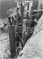"""""""Pouring concrete column supports for the west mixing plant."""" - NARA - 294068.tif"""