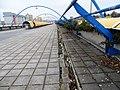 Černý Most, chodník na estakádě metra, rozbořený kanálek (01).jpg
