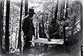 1945. Axel Brandstrom and Orr examine collecting tray. Hemlock looper control project. Clatsop County, Oregon. (33497002505).jpg