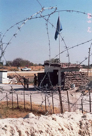 Photograph of the front entrance to the Australian base at Ondangwa from inside the wire