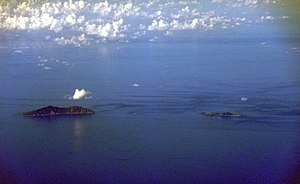 Senkaku Islands - A cluster of islets – Uotsuri-shima (left), Kita-Kojima and Minami-Kojima (right)