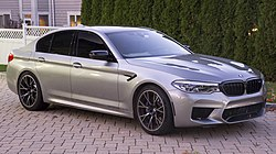 2019 BMW M5 Competition in Silver, front right (US).jpg