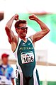 261000 - Athletics track 4x100m T46 Neil Fuller celebrates gold - 3b - 2000 Sydney race photo.jpg