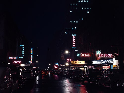 Looking east from 6th Avenue, 52nd Street at night (May 1948); photo by William P. Gottlieb
