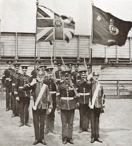 Colour party of the 9th Battalion Durham Light Infantry after receiving new colours from King Edward VII, 19 June 1909. 9th DLI colour party 1909.jpg