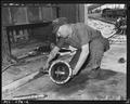 A. Duke, machine shop foreman, assembling differential of shuttle car. Pyramid Coal Company, Victory Mine, Terre... - NARA - 540347.tif