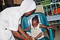 A Nigerian Nurse attending to a patient3.jpg