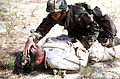 A Security Policeman from the 159th Security Police Squadron detains a foreign terrorist by holding him on the ground at the 159th Fighter Wing's 1995 Operational Readiness Inspection 951116-F-SZ645-001.jpg