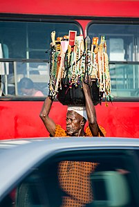 A bead trader in between two vehicles.jpg