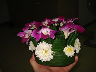 Loi Krathong - A hand-made krathong, made from banana tree trunk and banana leaves, held together with pins, and decorated with flowers