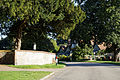 A tree lined Park Road Little Easton Essex England.jpg