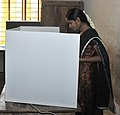 A woman voter casting her vote, at a polling booth, during the 6th Phase of General Elections-2014, in Puducherry on April 24, 2014.jpg