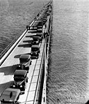 Aerial view of cars and pedestrians on the Hornibrook Highway Bridge Redcliffe 1935 (7960321652).jpg