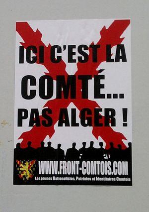 """Front Comtois - Placard of Front Comtois: """"Ici c'est la Comté, pas Alger"""" (""""Here it's the Comty, not Alger"""")."""