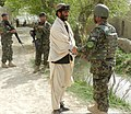 Afghan National Army Brig. Gen. Ahmed Habibi, right, the commander of the 1st Brigade, 205th Corps, exchanges greetings with a resident near the village of Sperwan, Panjwai district, Kandahar province 120401-A-OR326-033.jpg