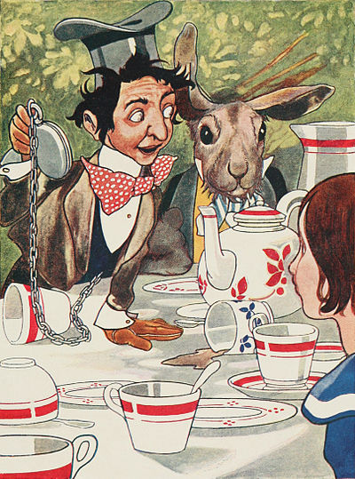 The Hatter, wearing an upside-down top hat and a surprised expression, leans over the messy table, holding his pocket-watch aloft.