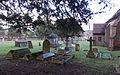 All Saints Theydon Garnon north churchyard from west (Nikon L810).jpg